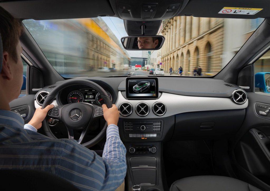 an interior shot of someone driving a 2015 Mercedes-Benz B-Class