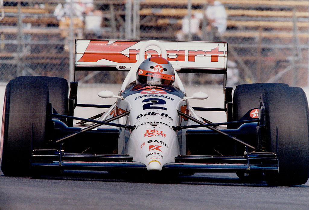 A white race car driven by Michael Andretti that inspired the design of the record-breaking car made of cake
