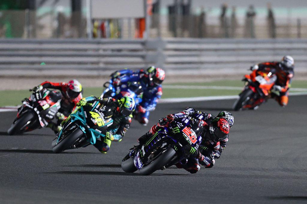 Monster Energy Yamaha racer Fabio Quartararo leads a pack of MotoGP riders at the 2021 Qatar GP