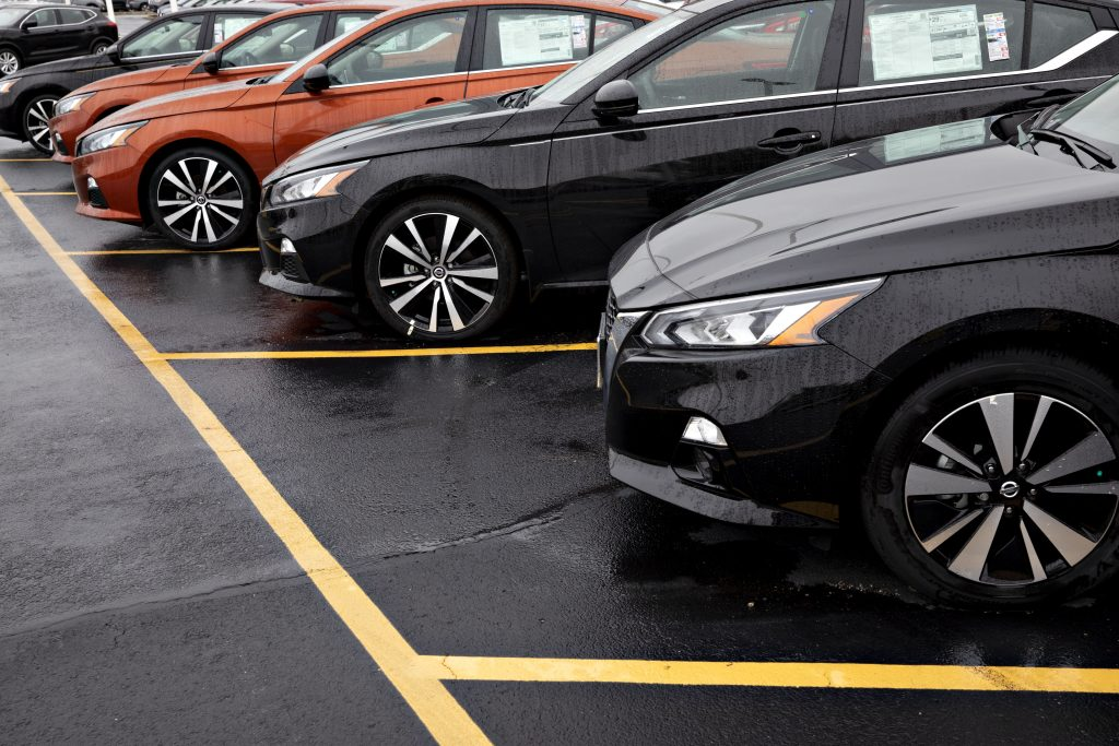 A row of Nissan Altima cars at a dealership