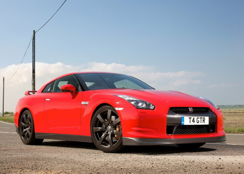An image of a red Nissan GT-R parked outside.