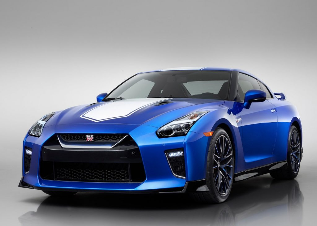 An image of a blue Nissan GT-R in a photo studio.