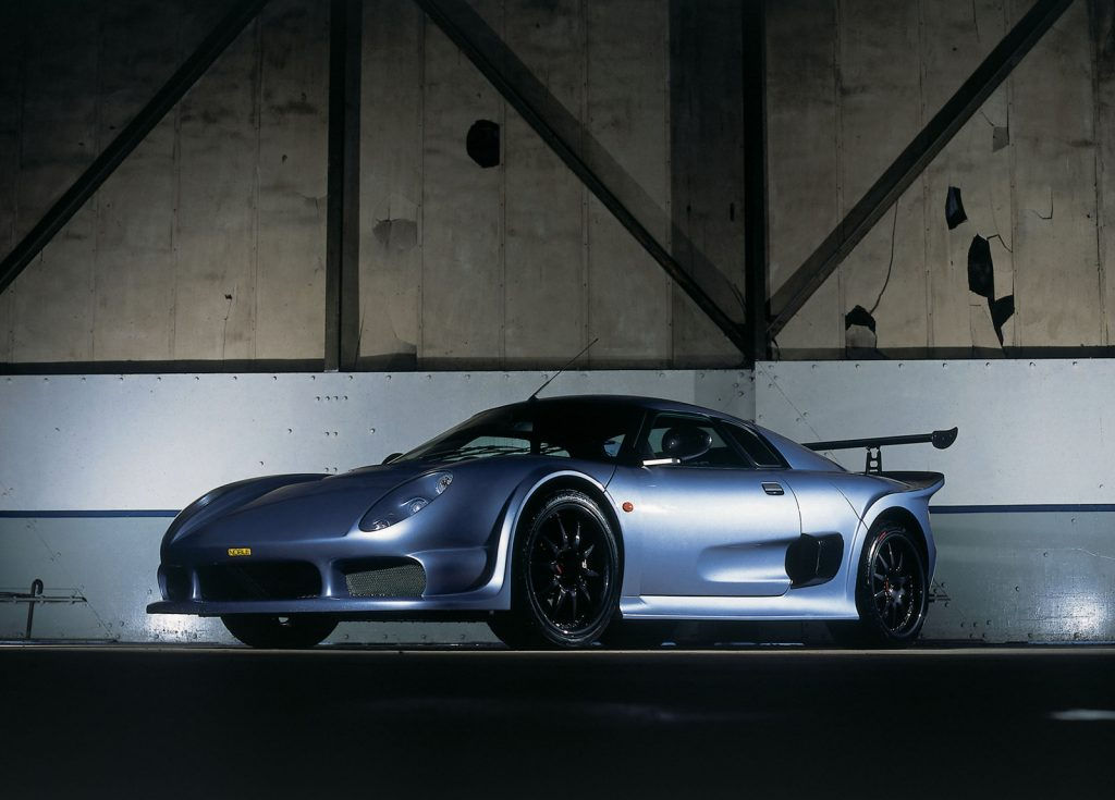 An image of a Noble M400 inside of a hangar.