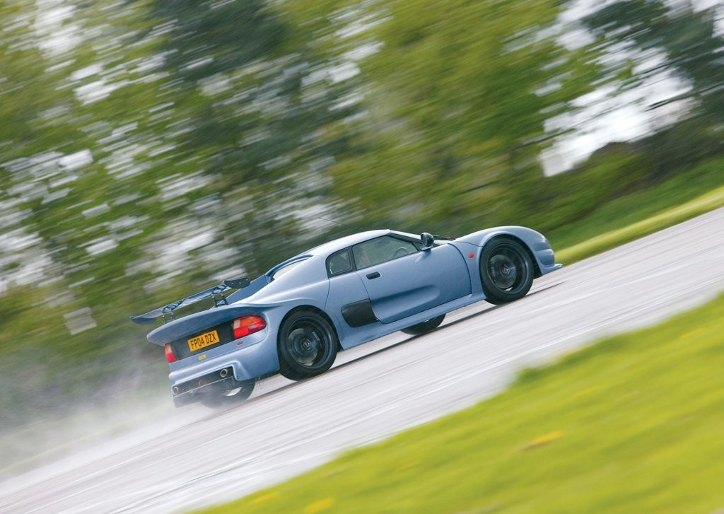 An image of a Noble M400 out on track.