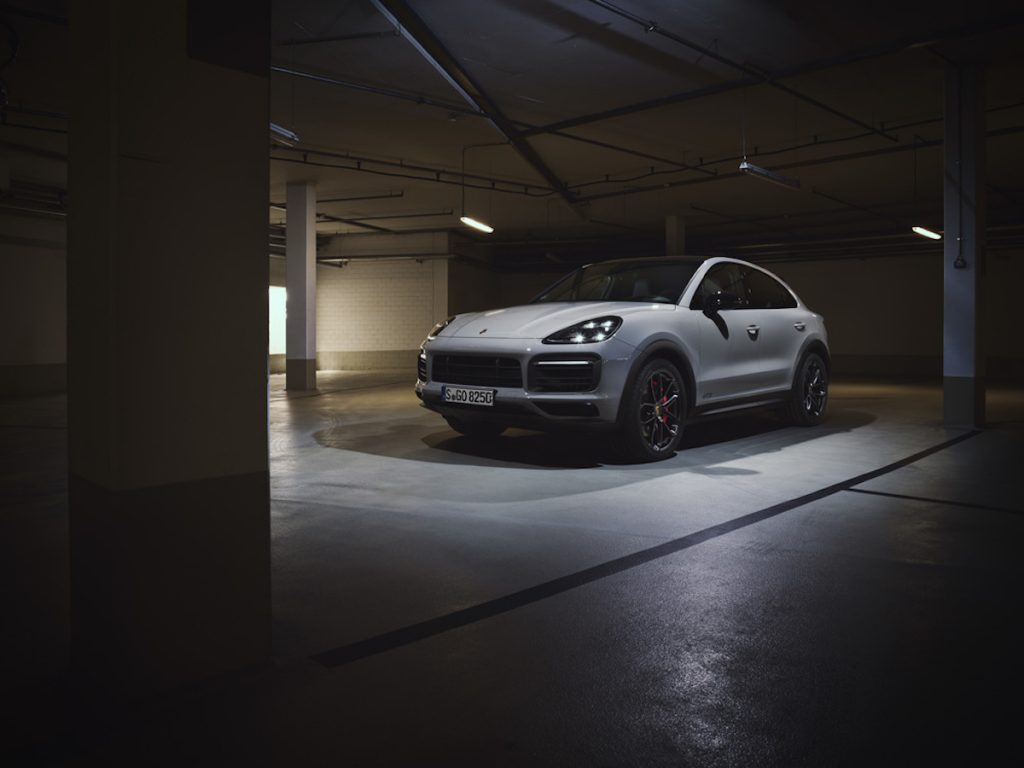 white 2021 Porsche Cayenne GTS in a fancy garage