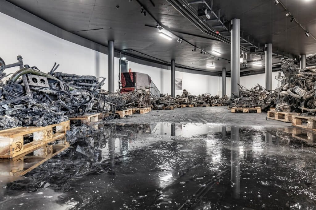 Part of the remnants from the Top Point Motorcycle Museum's burned collection on pallets