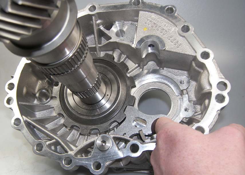 A picture of a parking pawl in an automatic transmission