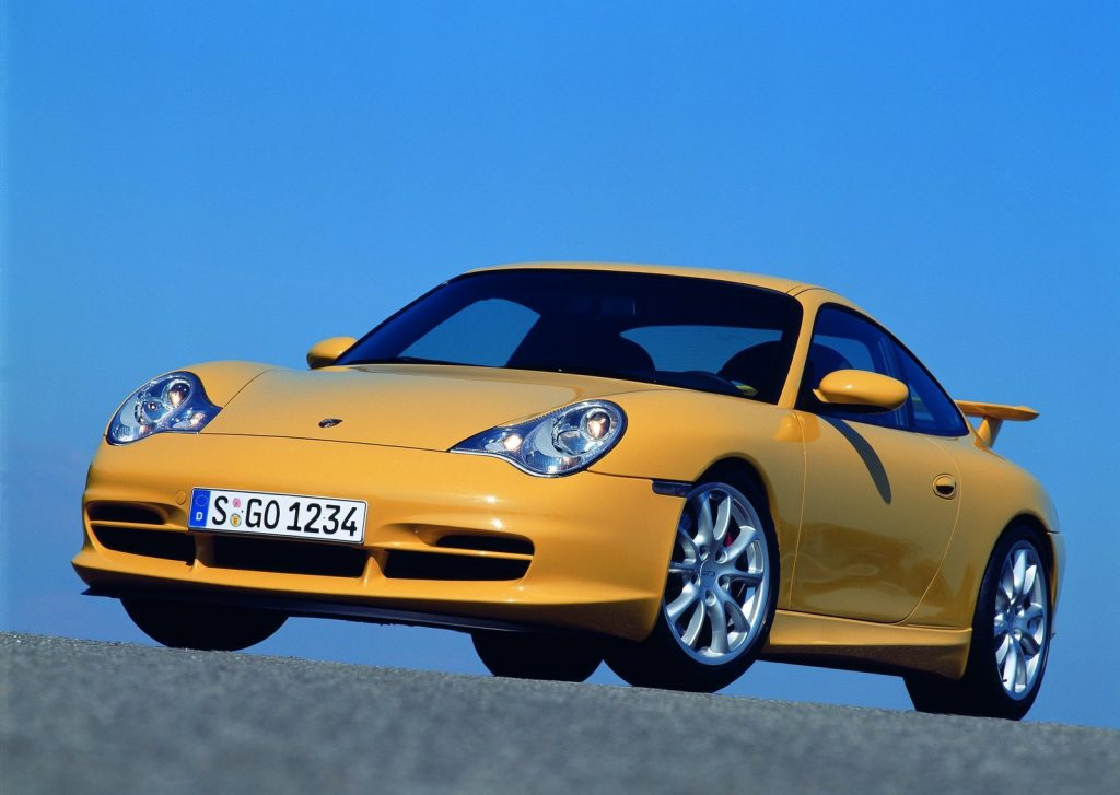 An image of a yellow Porsche 911 GT3 parked outside.