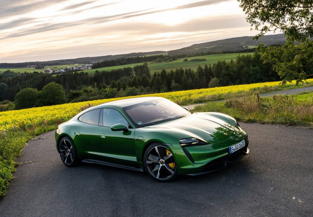 An image of a green Porsche Taycan Turbo S parked outside.