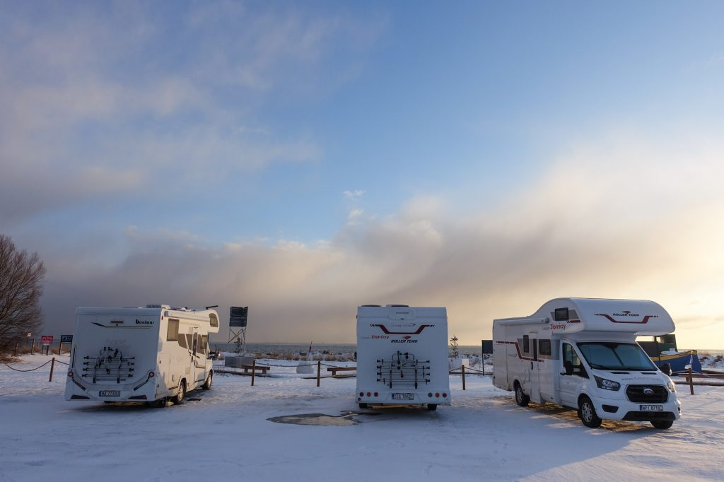 RVs parked by the sea in Mechelinki, Poland, on February 6, 2021