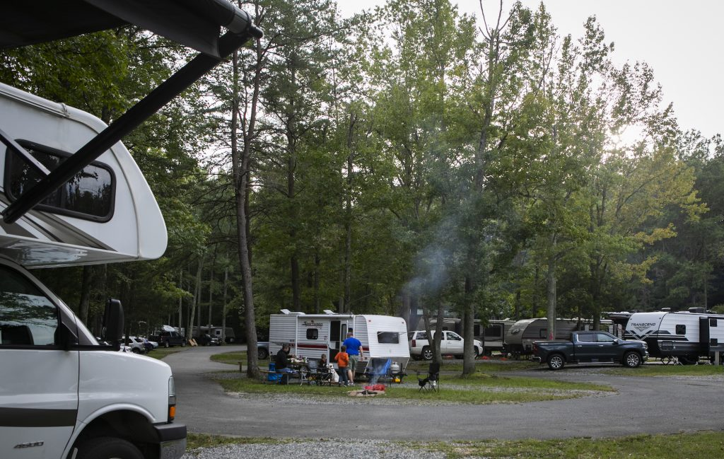RV campers make a fire at a KOA campground in Fredericksburg, Virginia, on Saturday, September 19, 2020