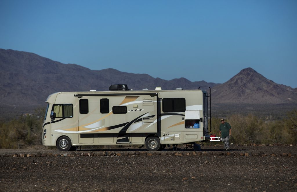 Paul Ostrom, age 67, of Sandpoint, Idaho, walks outside his RV, parked at the La Posa long-term visitor area in Quartzsite, Arizona