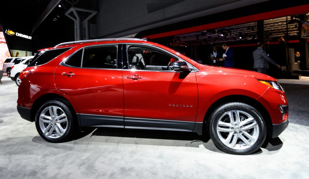 A red Chevy Equinox on display at an auto show