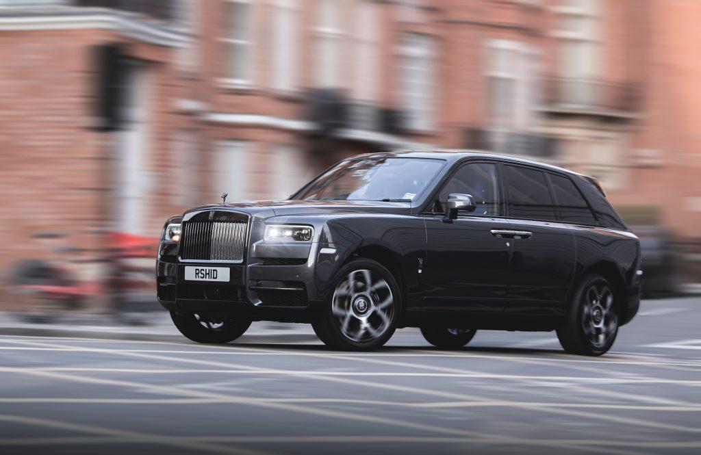Rolls Royce Cullinan rolling down the street in the UK