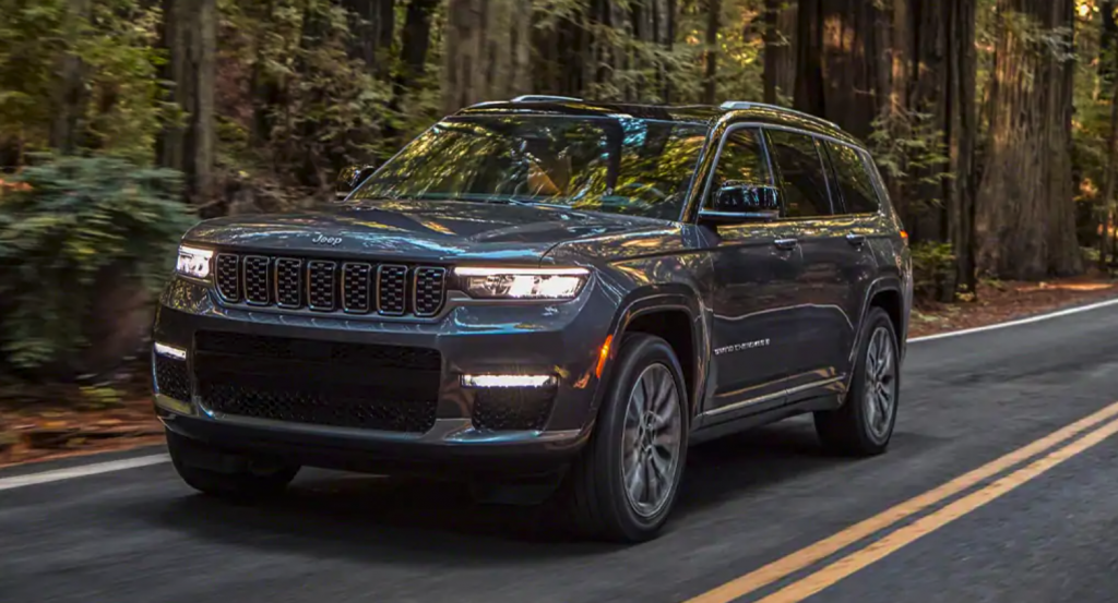 The 2021 Jeep Grand Cherokee L driving on wooded road