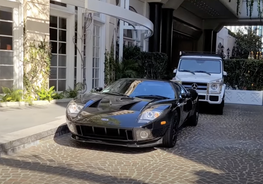 An image of a Ford GT parked outside of a hotel in Beverly Hills.