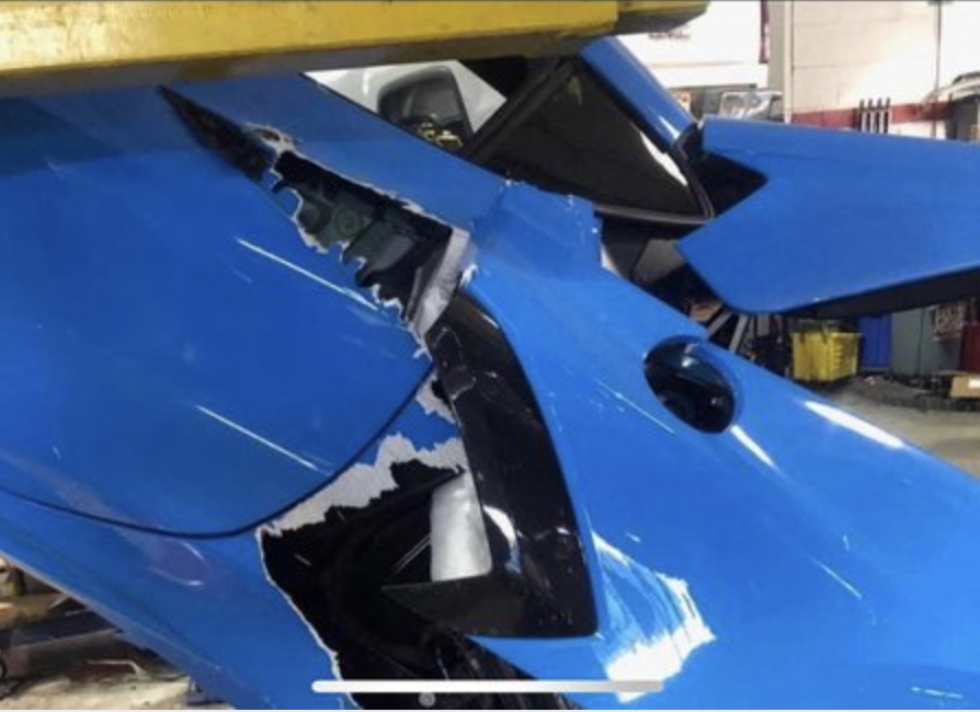 An image of a 2021 Chevrolet Corvette that fell from a mechanic's lift.