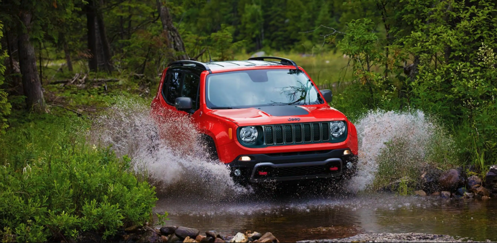 The 2021 Jeep Renegade going through a stream