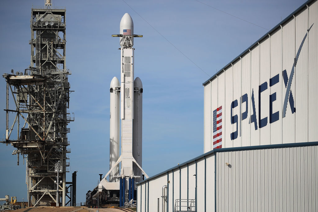 The Space X Falcon launching behind the Space X hanger in Canaveral Florida