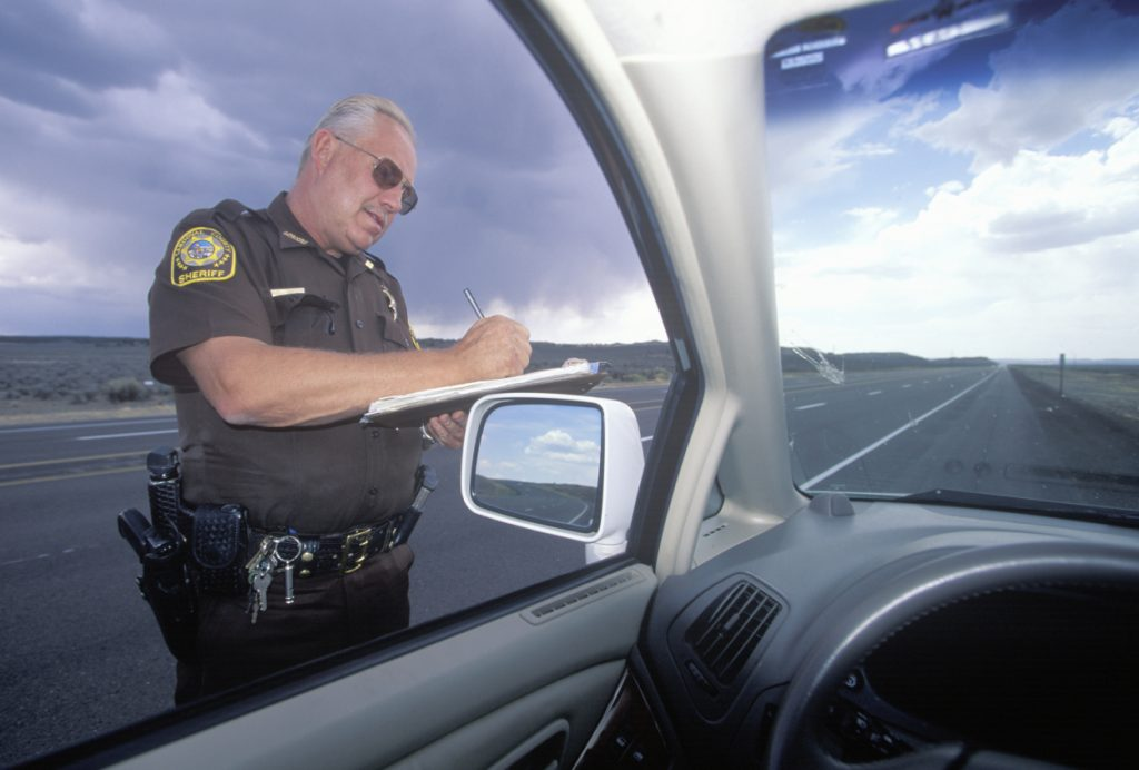 A police officer writing a speeding ticket