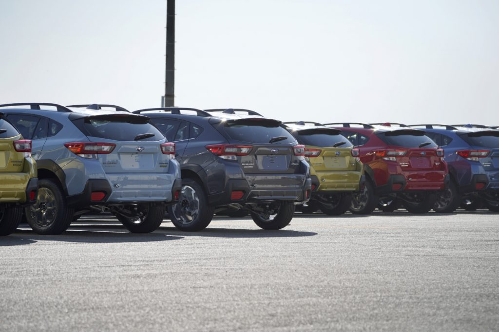 A row of Subaru Crosstrek lined up and ready to be shipped