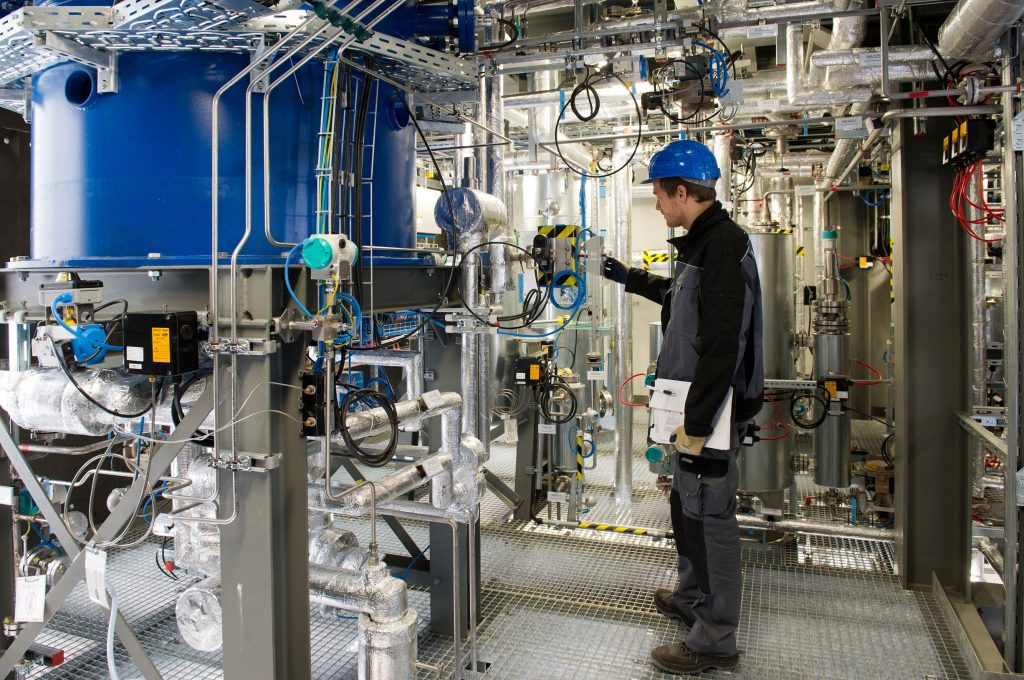 A work checks equipment in Sunfire's Dresden, Germany synthetic fuel pilot plant