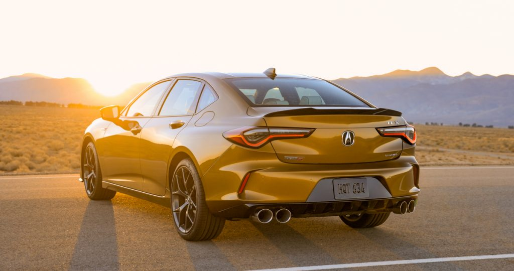 a rear shot of the 2021 TLX Type S shown in Tiger Eye Pearl paint