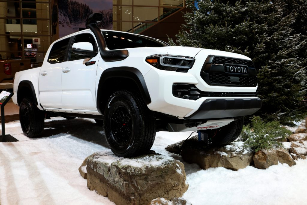 A white 2020 Toyota Tacoma TRD Pro on display at an auto show