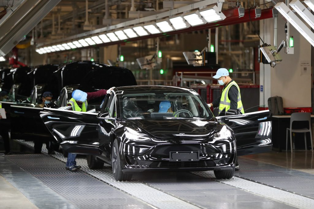 Employees work at the Tesla Gigafactory in Shanghai, east China, Nov. 20, 2020. U.S. electric car company Tesla in 2019 built its first Gigafactory outside the United States