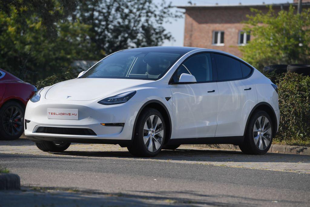 A white Tesla Model Y sedan parked outdoors