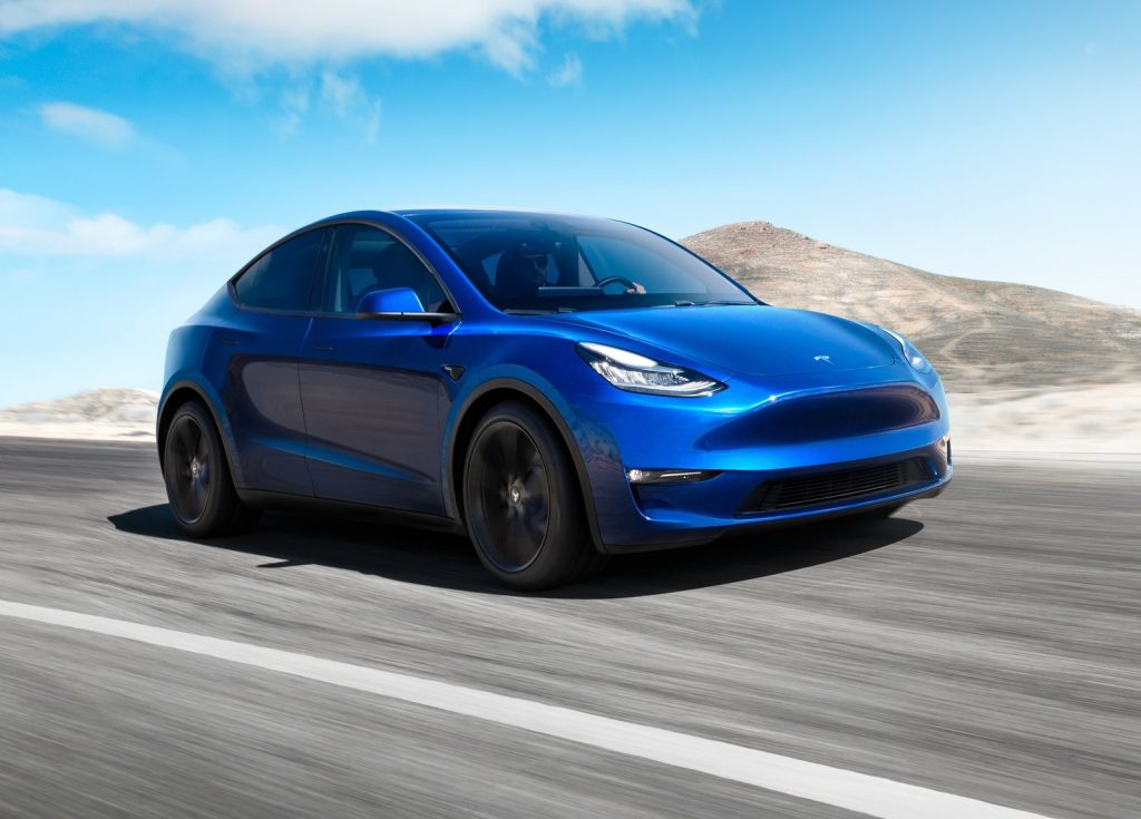An image of a Tesla Model Y out on a race track.