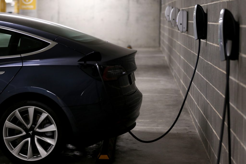 A Tesla Model Y plugged in and charging at home