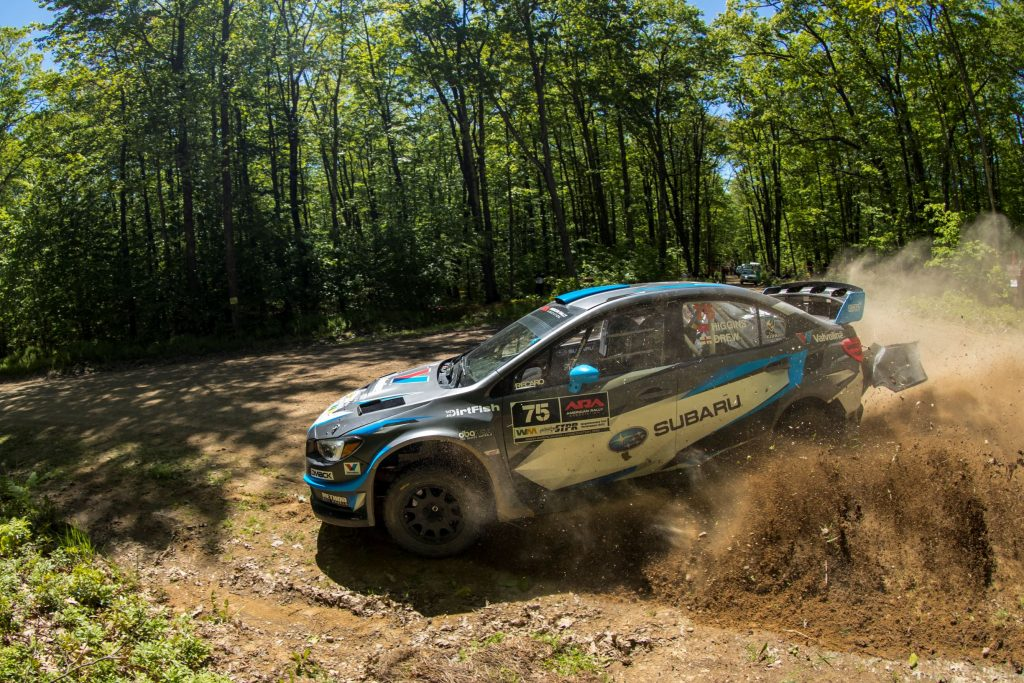 The black-blue-and-white #75 Subaru Rally Team WRX slides through the dirt at the 2017 Susquehannock Trail Performance Rally in Pennsylvania