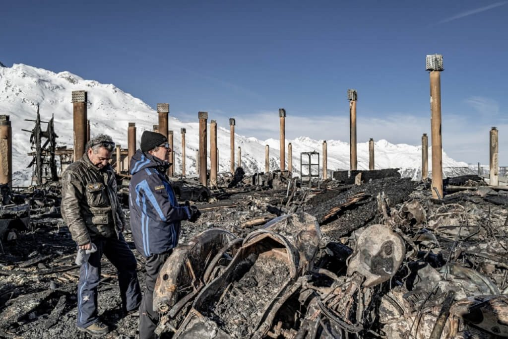 The Scheiber brothers at the burned remnants of the Top Point Motorcycle Museum