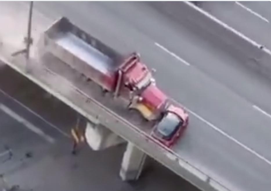 Toronto dump truck dragging a Mini sideways