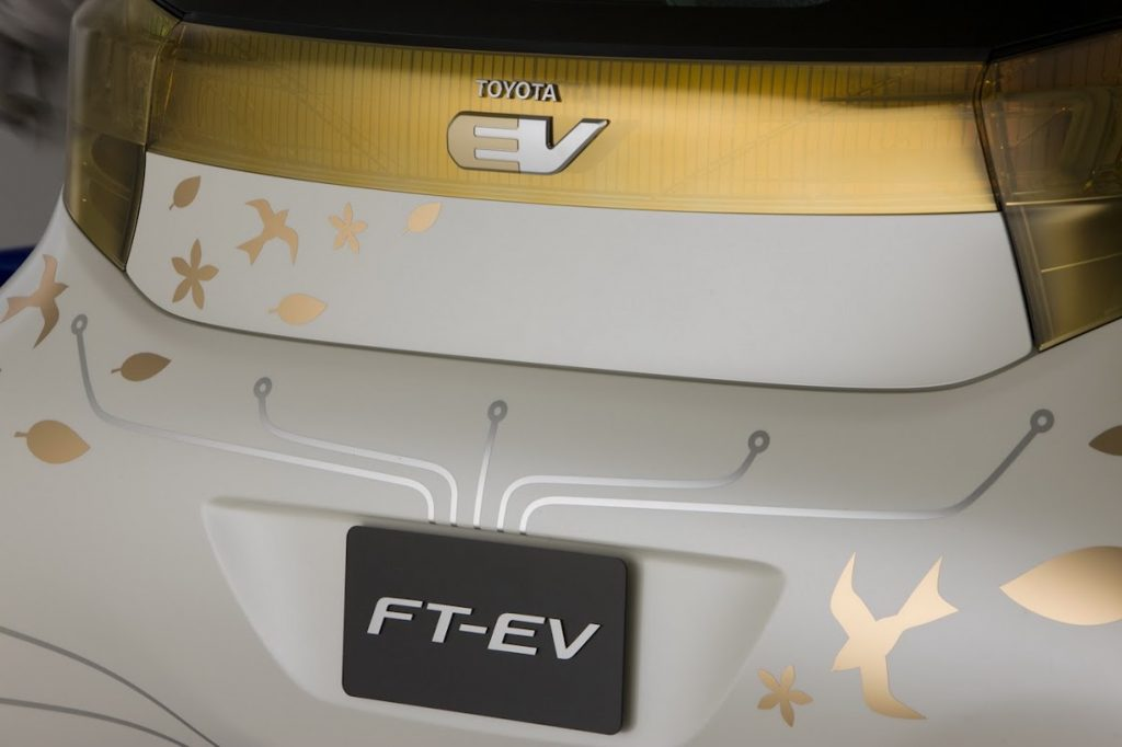 Gold and white Toyota EV back hatch