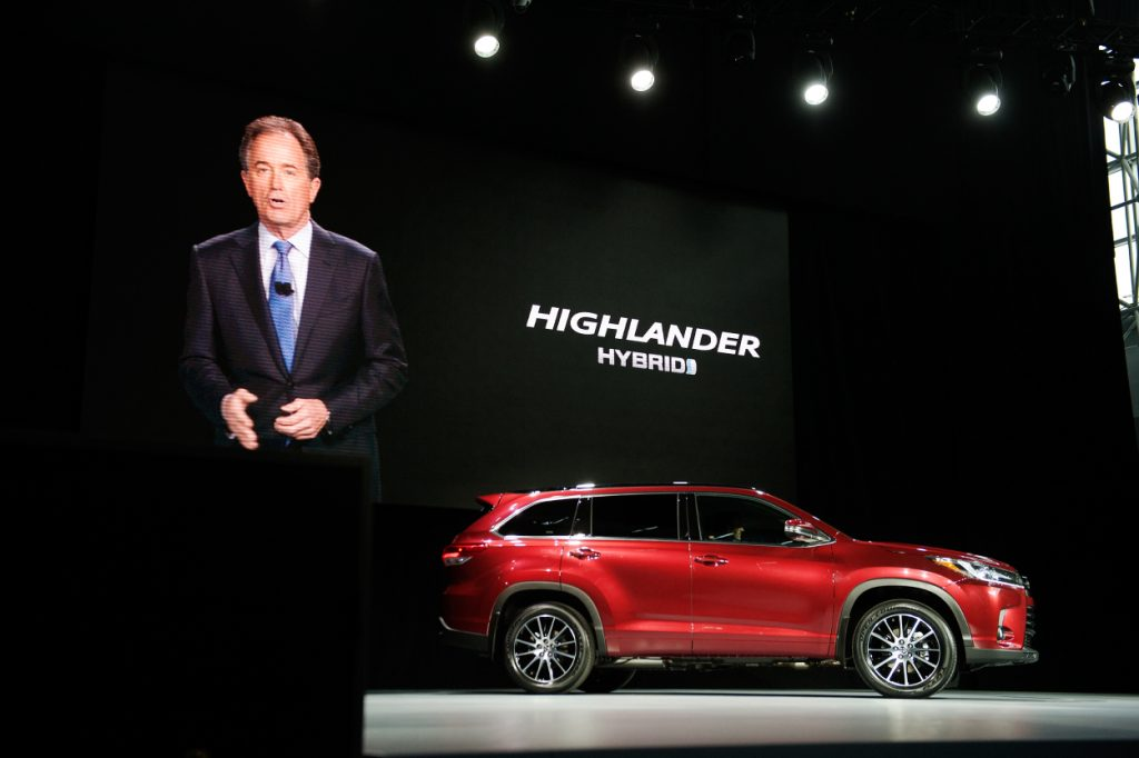 A new Toyota Highlander Hybrid being unveiled at an event