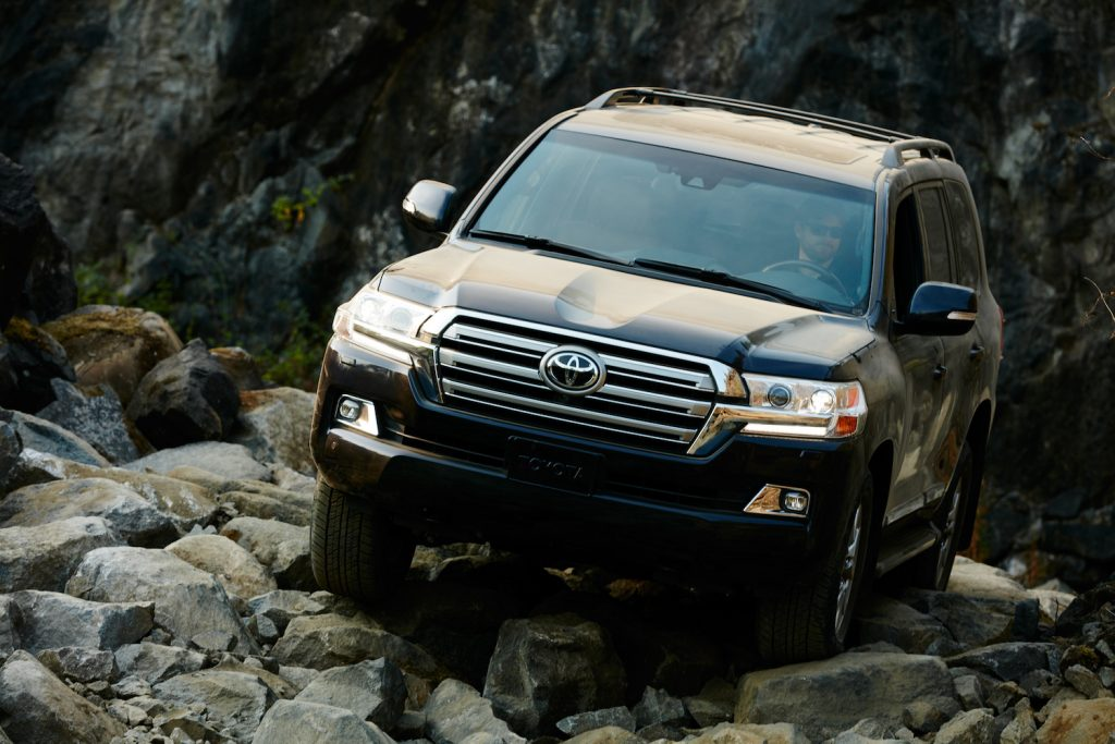 The Toyota Land Cruiser climbing over rocks