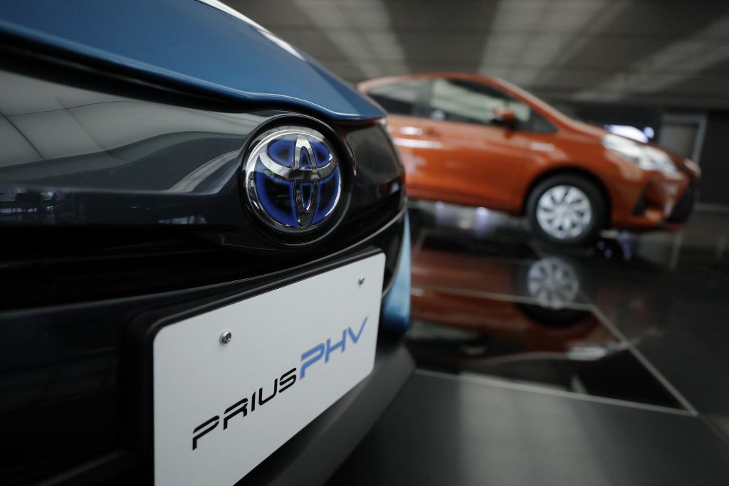 A Toyota Motor Corp. badge is displayed on a Prius plug-in hybrid vehicle (PHV), known as Prius Prime in the U.S., at the company's head office in Tokyo