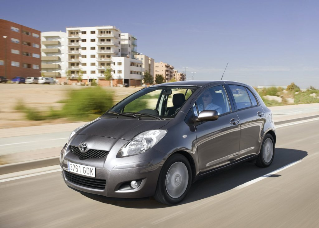 a grey 2009 Toyota Yaris driving