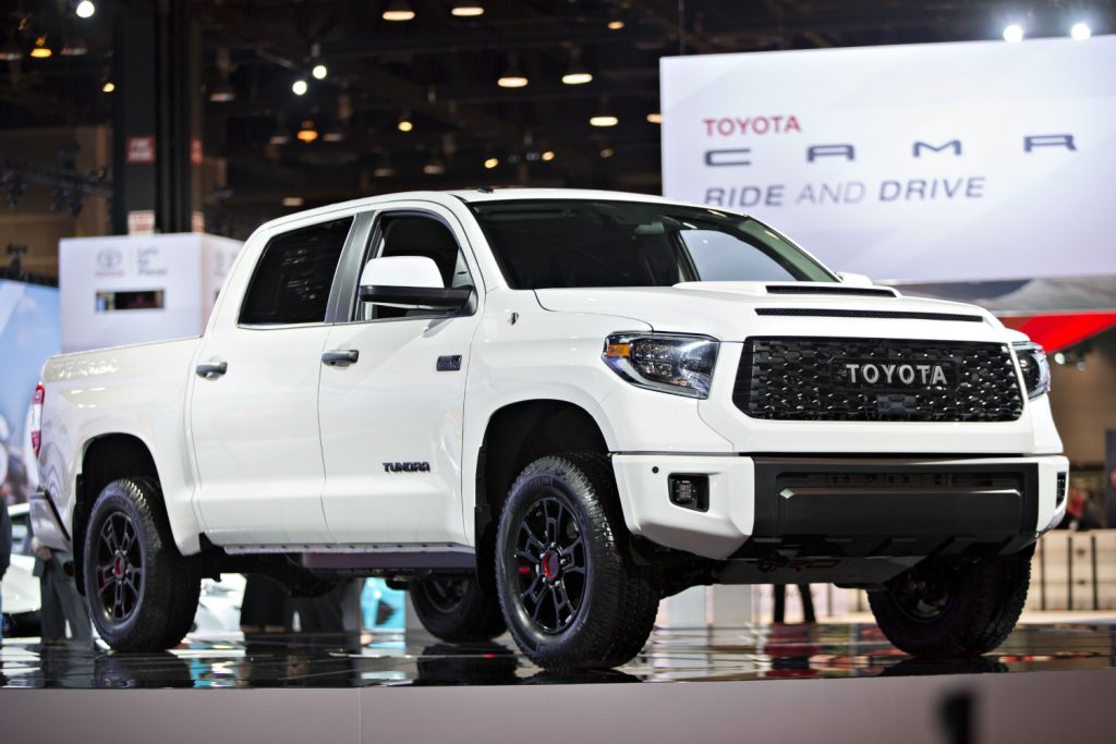 A white Toyota Tundra TRD Pro on display at an auto show