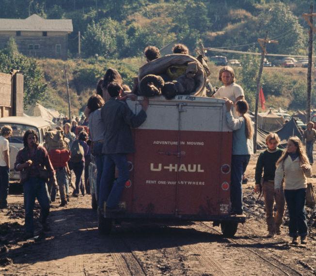 U-Haul trailer with hippies around it