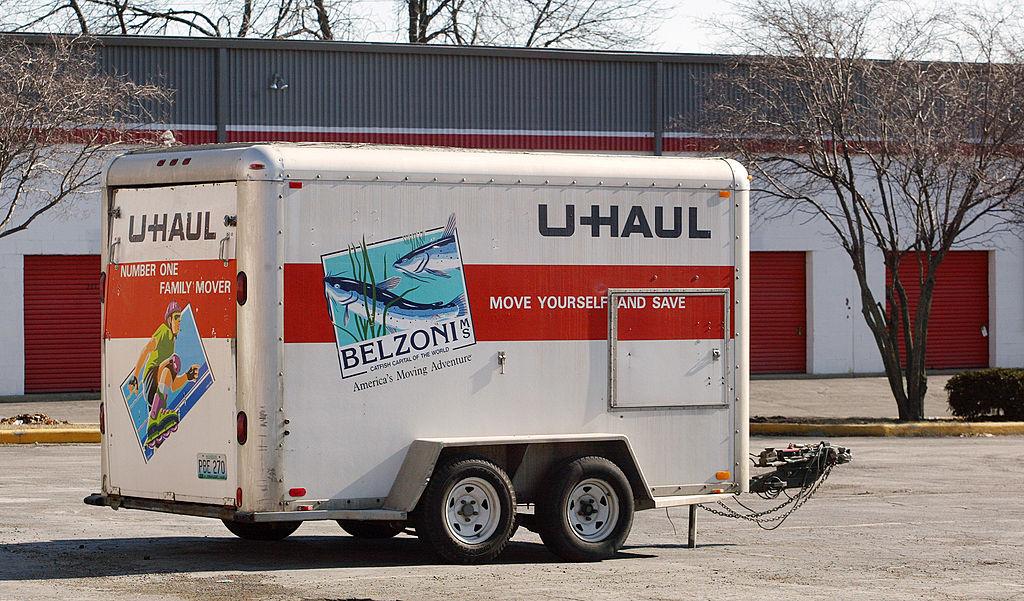U-Haul trailer looking abandoned in a parking lot