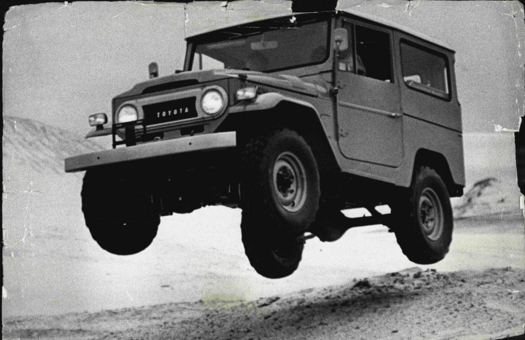A 1970 Toyota Land Cruiser jumping sand hills