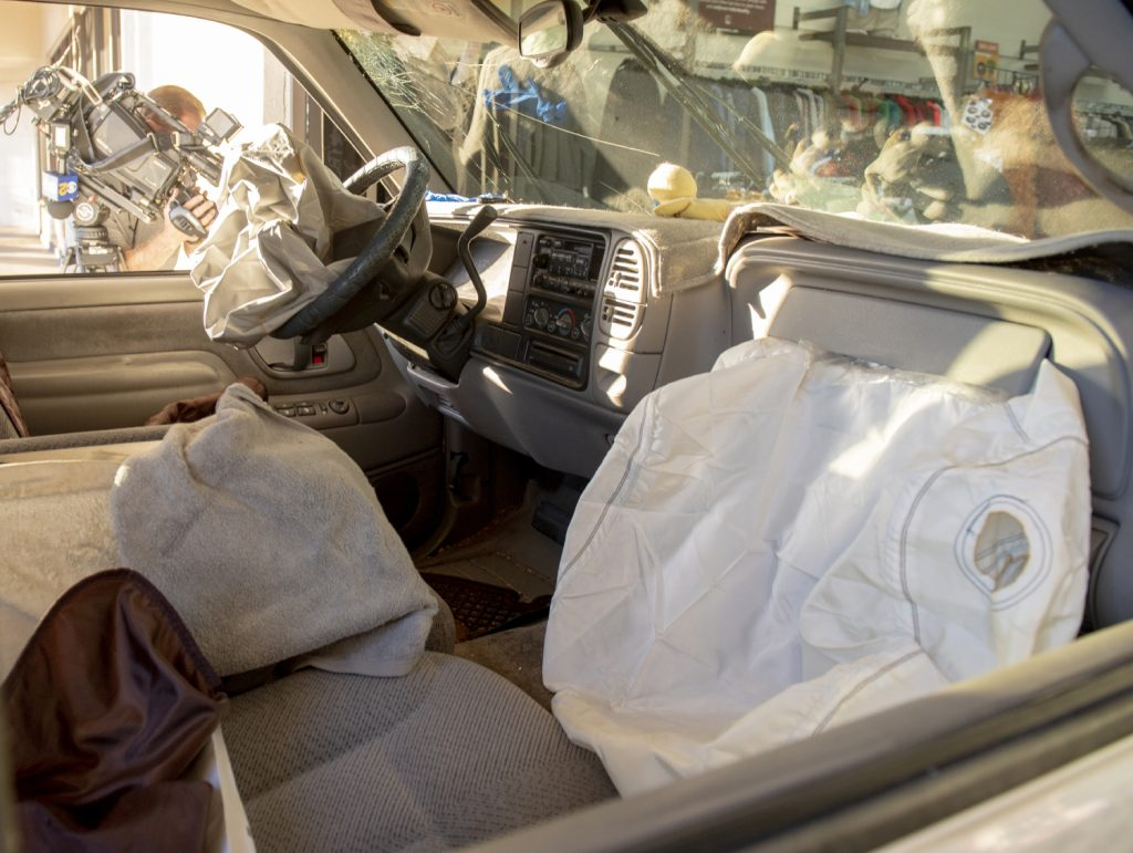 A set of deployed air bags in a car