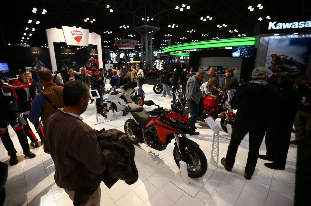 Visitors look at motorcycles from various brands at the Progressive International Motorcycle Show