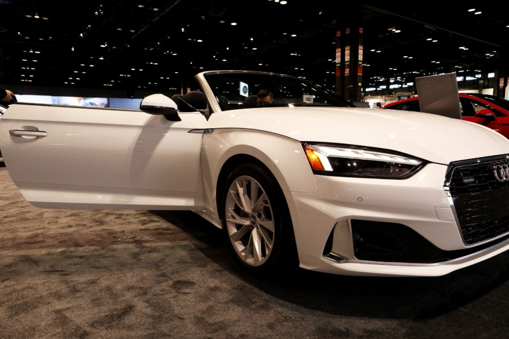A white Audi A5 on display at an auto show
