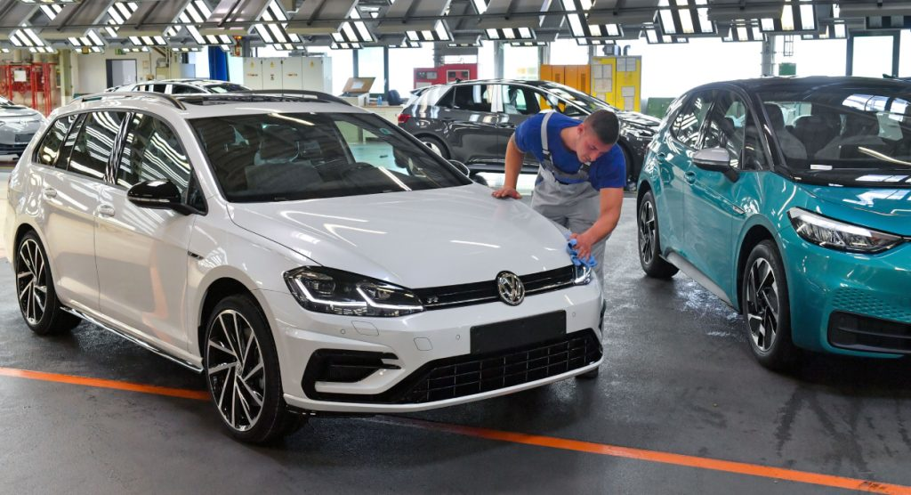 A man wipes down a Volkswagen Golf