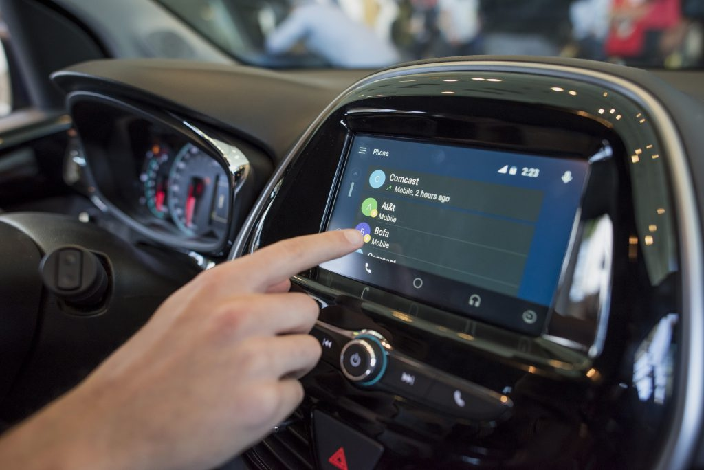 An attendee demonstrates Android Auto in a Chevrolet Spark car during the Google I/O Annual Developers Conference