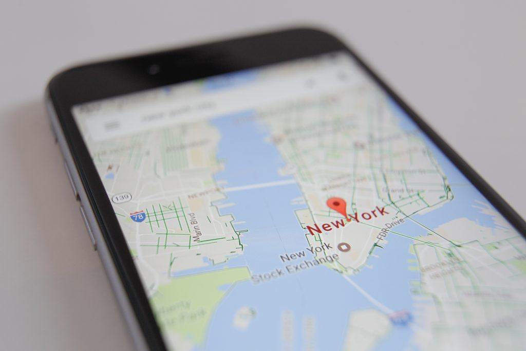 The Google Maps app is seen displaying part of the Manhattan district on a smartphone.